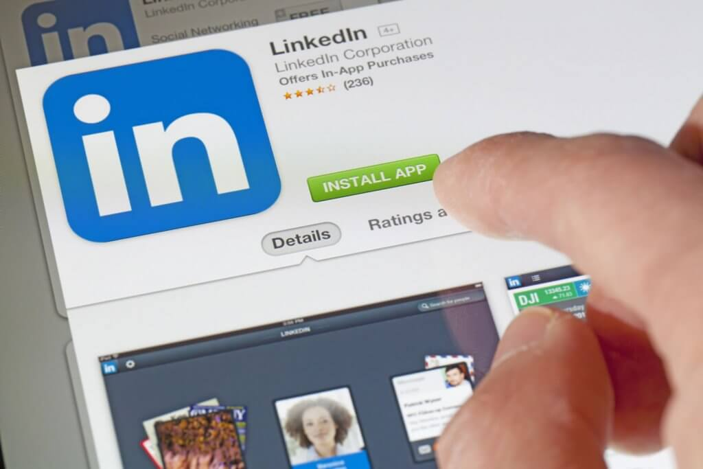 Photo of person installing LinkedIn app