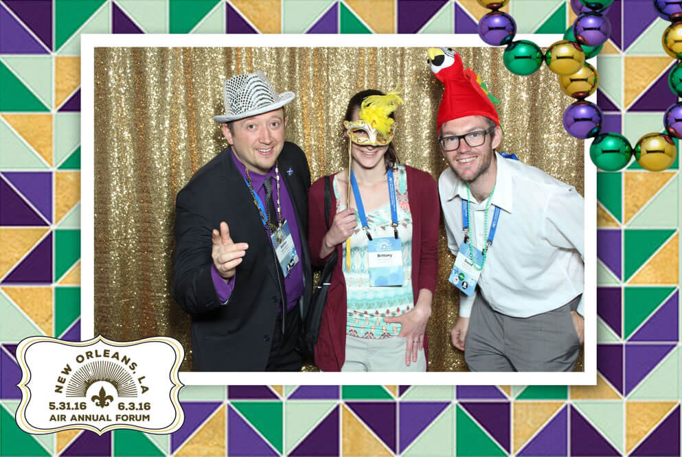 Photo of David Carroll and colleagues wearing silly hats at the AIR Forum 2016