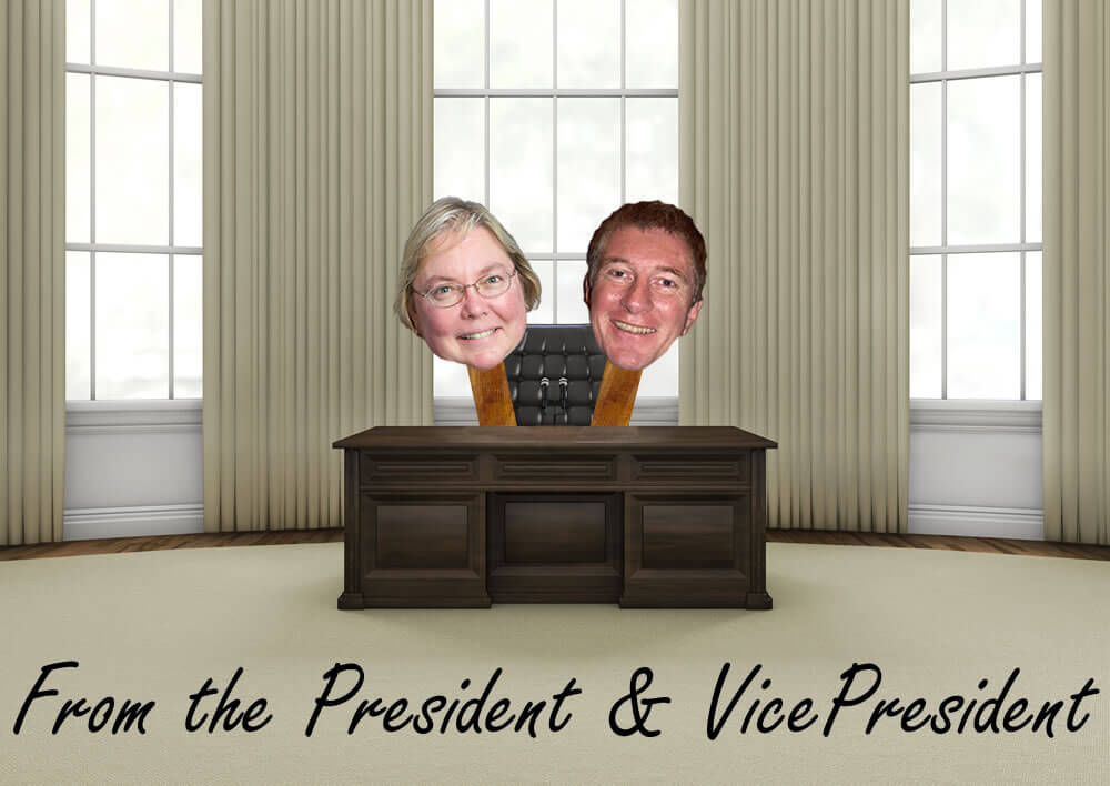 Picture of Kathie and Don behind a desk