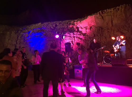Photo of the people dancing in coloured lights at the 2017 Forum Dinner venue - The Old Quarry, Alice Springs
