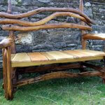 Photo of a garden bench chair made from natural tree branches