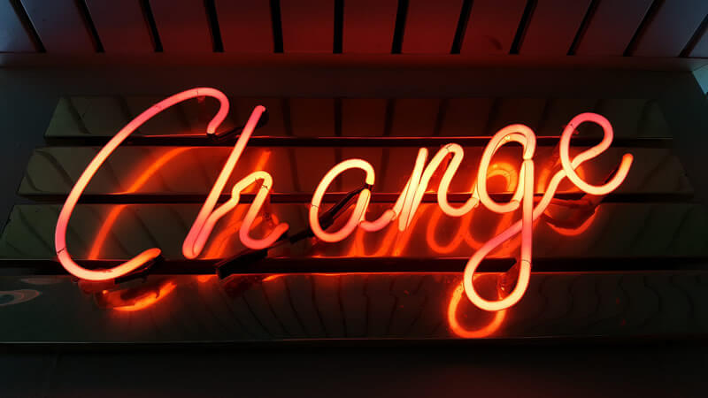 Photo of a neon sign spelling the word 'Change'