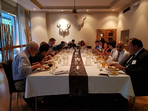 Photo of delegates around the dinner table at the AAIR regional dinner meeting in Melbourne