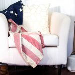 Photo of a comfy armchair with cushion and US flag