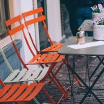 Photo of four chairs outside a cafe