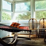 Photo of a hammock indoors with a couple of kitchen chairs