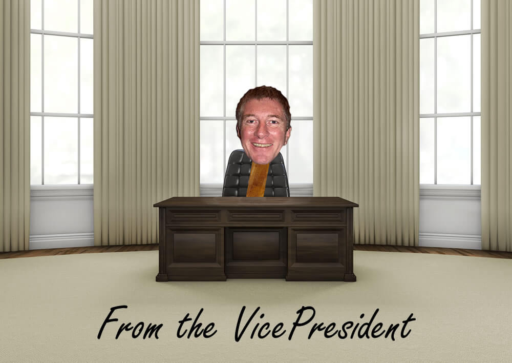 Picture of Don behind a desk