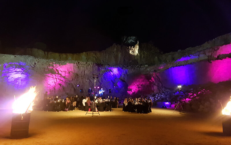 Photo of the old quarry in Alice Springs after dark with colourful lights