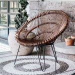 Photo of a circular wicker style chair on a circular mat