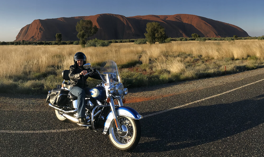 Photo of Andrea Jeffreys on a motor bike at Uluru