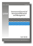 Cover of an academic journal with blue and black stripes across it