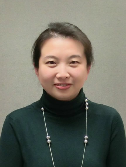 Photograph of Lizzie Li wearing a black sweater and a necklace