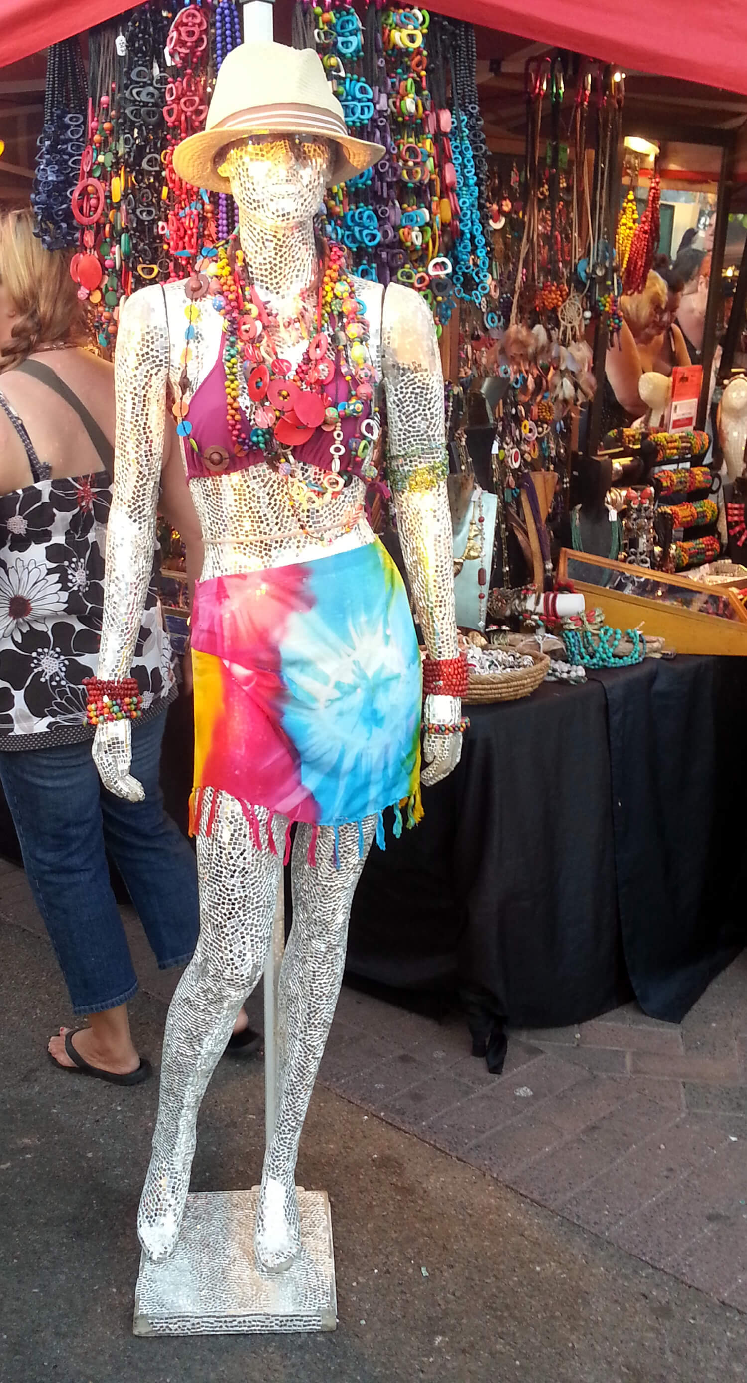 Photo of a market stall at Mindil Market in Darwin showing a hippy mannequin dressed in tie-dyed outfit and lots of jewellery