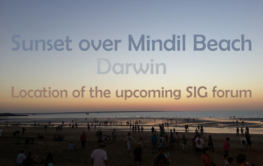 Photo of a sunset over a beach in Darwin with people scattered across the sand and the words: Sunset over Mindil Beach Darwin etc.