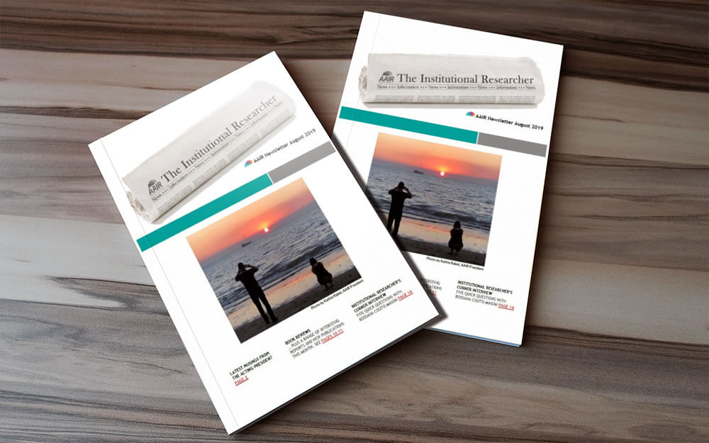 Two copies of the AAIR newsletter for August 2019 sitting on a timber surface