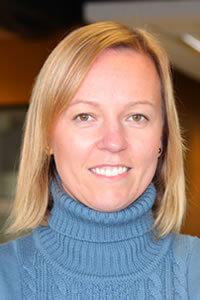 Photo of Ewa Seidel wearing a blue polo neck sweater