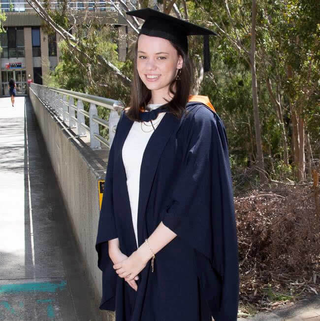 Photo of Liz Hemsley wearing her graduation gown, colours and mortar board