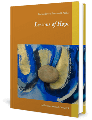 Cover of a book with an abstract painting and a stone resting on it