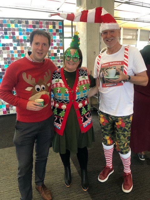 Photo of three people dressed in really bad Christmas outfits at a party